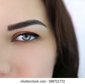 Young beautiful woman in cosmetology salon