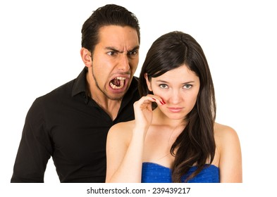 young beautiful woman crying while husband boyfriend screams at her isolated on white