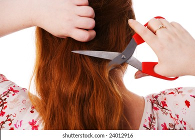The young beautiful woman cuts red long hair, white background, a close up