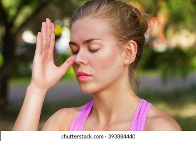 young beautiful woman doing breathing exercise,