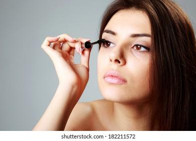 Young beautiful woman doing makeup