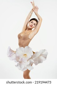 Young beautiful woman dressed in elegant dress of fresh white flowers