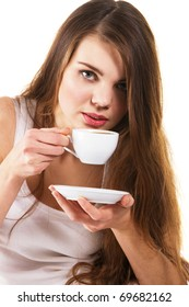 Young beautiful woman drinking morning coffee