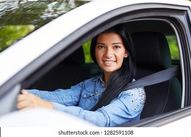 Young beautiful woman driving her car