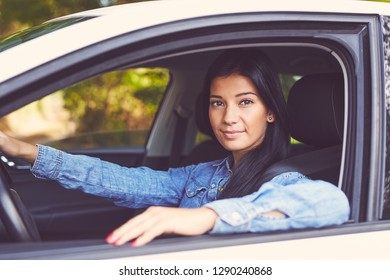 Young beautiful woman driving her car. Toned image