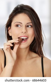 Young beautiful woman eating bar
