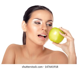 Young beautiful woman eating green apple isolated over white background