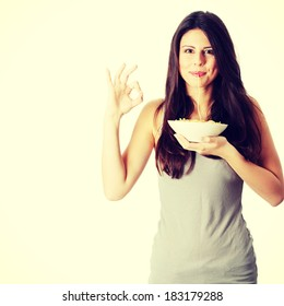 Young beautiful woman eating spaghetti, isolated on white background