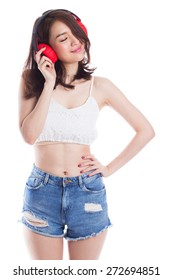 Young beautiful woman enjoy listening to music with headphones on white background