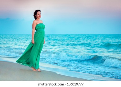 Young beautiful woman enjoying beach vacation