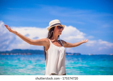 Young beautiful woman enjoying the holiday on white tropical beach