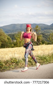 young beautiful woman exercise in nature