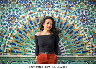 Young beautiful woman exploring the Hassan II Mosque
