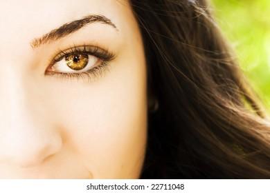 Young beautiful woman eye, right copyspace
