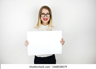 young beautiful woman in eyeglasses holding blank sheet of paper isolated white background space for text