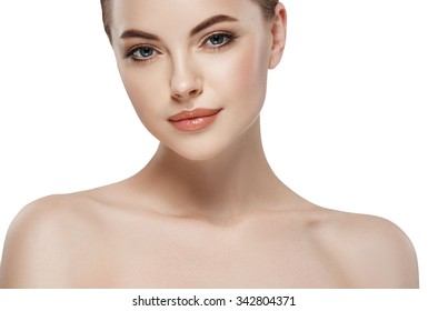 Young beautiful woman face close-up beauty portrait with healthy nature skin and perfect make-up