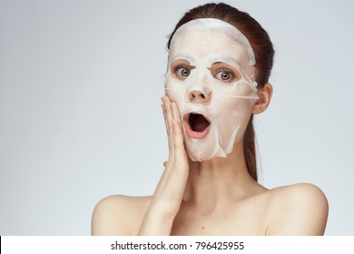 young beautiful woman in a face mask, skin care