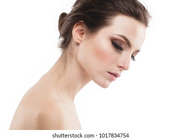 Young beautiful woman face portrait with healthy skin. Studio shot.