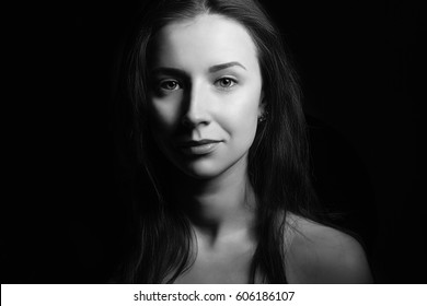 Young beautiful woman fashion portrait black and white. Clean skin. Natural beauty without makeup.