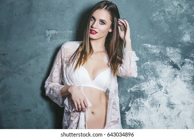 Young beautiful woman in a fashionable linen luxury brunette in the Studio