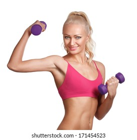 Young beautiful woman in fitness wear with dumbbells