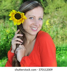 young beautiful woman with flowers outdoor
