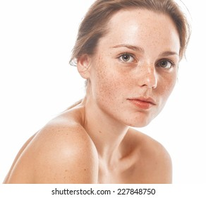 young beautiful woman with freckles portrait studio on white background