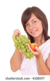 young beautiful woman with fresh grapes and peach isolated on white