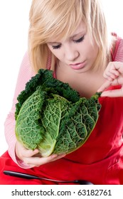 young beautiful woman with fresh savoy cabbage on white background