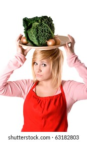 young beautiful woman with fresh savoy cabbage and onions on her head isolated