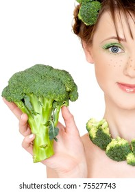 The young beautiful woman with the fresh vegetables, isolated on the white