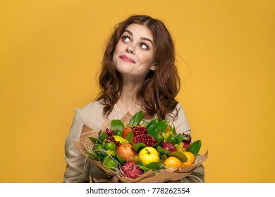 young beautiful woman with a fruit bouquet