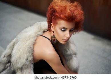 Young beautiful woman in a fur coat