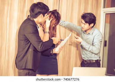Young beautiful woman gesturing and discussing something with angry while her coworkers listening at the office.