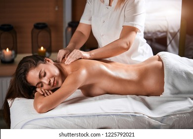 Young beautiful woman getting spa treatment at beauty spa salon. Getting rid of negative emotions, stress and worries. Wellness massage. Beauty treatment.