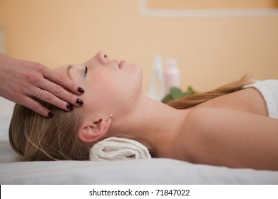 Young beautiful woman getting treatment   in spa salon.