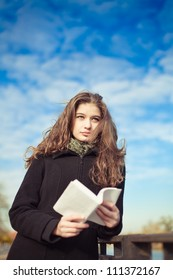 Young beautiful woman girl with book