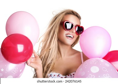 Young beautiful woman with glasses holding pink balloons, valentine's day, isolated