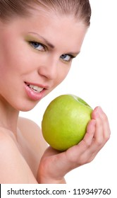 Young Beautiful Woman With Green Apple Loking Towards Camera