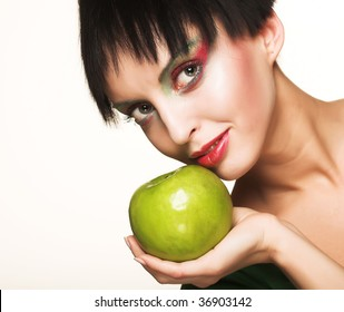 Young beautiful woman with  green apple isolated over white background
