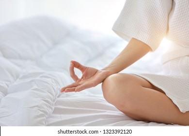 young and beautiful woman hands enjoying in meditates with yoga pose in bedroom