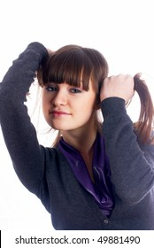 young beautiful woman with hands in hair at isolated background