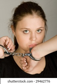 young beautiful woman with hands in handcuffs