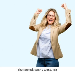Young beautiful woman happy and excited celebrating victory expressing big success, power, energy and positive emotions. Celebrates new job joyful