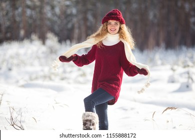 Young beautiful woman having fun in winter time outdoors
