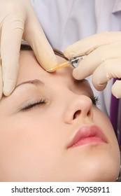 A young beautiful woman having an injection, closeup
