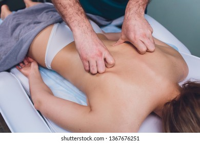 Young beautiful woman having massage in spa salon Physiotherapis.