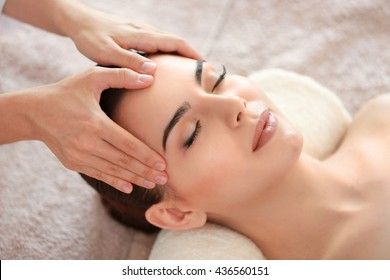 Young beautiful woman having spa massage on her face