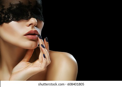 Young beautiful woman with healthy flawless skin, big lips posing on black background. Model hides her eyes by lace, touching face. Female beauty, advertising concept. Copy, empty space for text