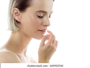 Young beautiful woman healthy perfect beauty skin and natural makeup with hand